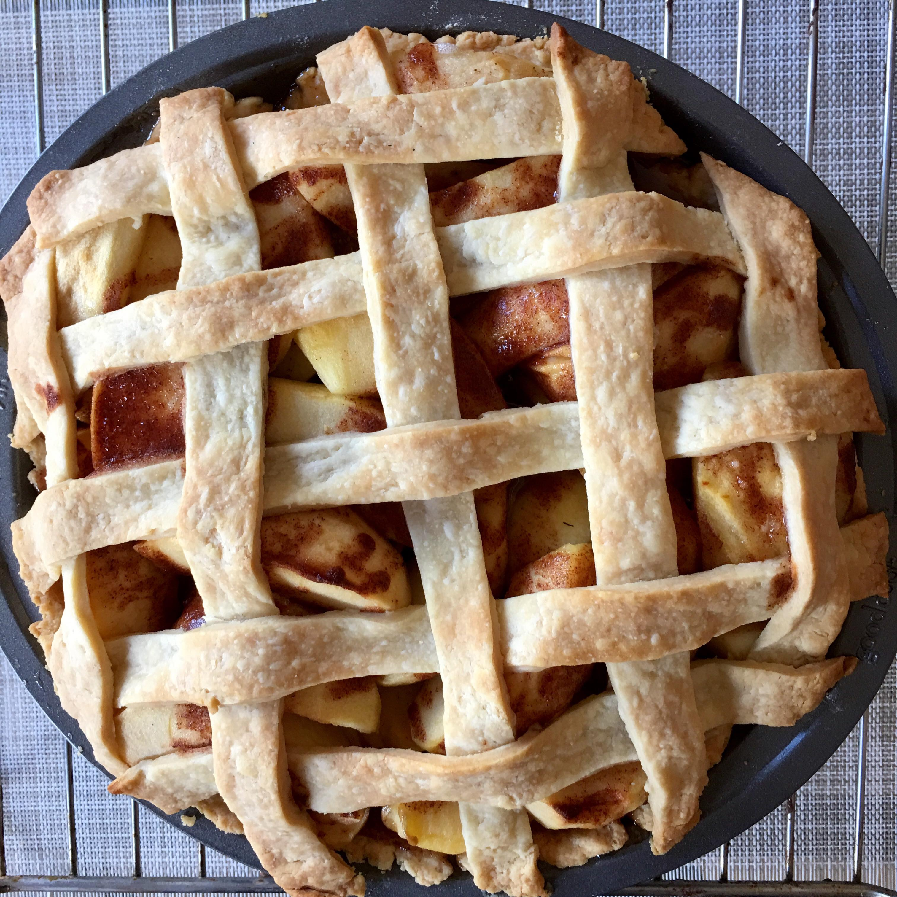Apple pie on cooling rack