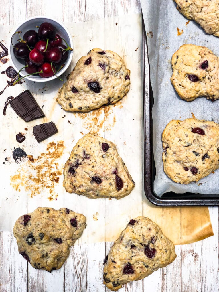 Learn how to make sourdough scones! Buttery scones studded with sweet cherries and semisweet chocolate make for a wonderful breakfast or teatime treat. A cup of sourdough discard adds a perfect tangy background to the medley of flavors.
