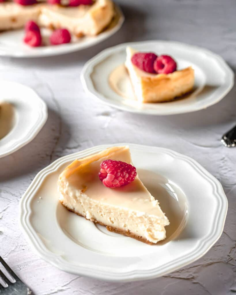 A slice of white chocolate cheesecake on a plate